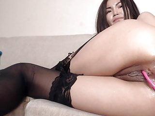 Asian fucks her tight pussy..