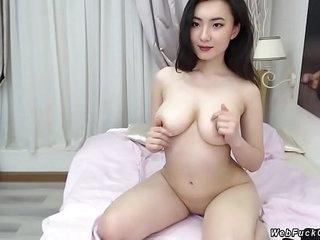 Natural busty Asian camgirl..