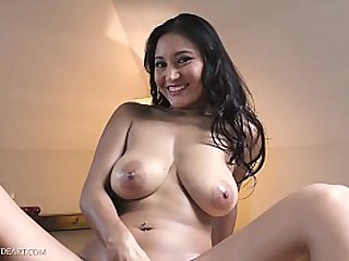 Busty Asian brunette plays..