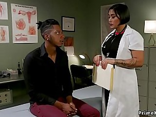 Busty brunette Asian doctor..